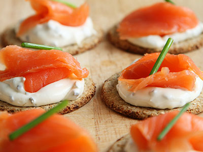 picture of raw salmon and cream cheese appetizers. Red-tinted fish such as salmon and krill know to be good food sources of the cartenoid Astaxanthin.
